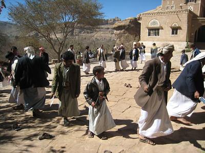 Mens dagger dance in the courtyard of Dar al-Hajjar.