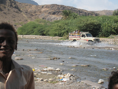 In the foreground is a local boy who seemed to end up in every photo I took.  A LandCruiser ute crossing the river in the background.
