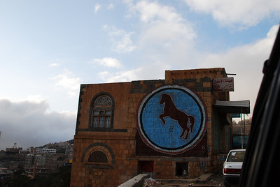 The horse is the symbol of the political party of the President of Yemeni, we saw it on buildings, hillsides and walls everywhere we went.  The symbol of the opposition parties is the sun.