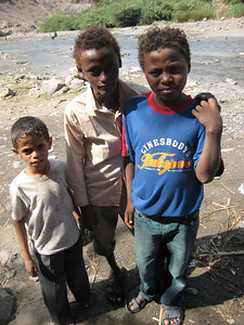 Three of the local kids, they live a hard life down there.
