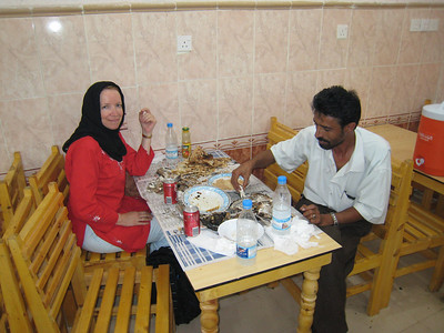 With Ali at the seafood restaurant in Hodaidah.  Note the newspaper 'tablecloth'.  This was the best seafood meal I've ever had in my life.  The full story is at  http://carolynn-dubailife.blogspot.com/2007/12/sana-yemen-day-2-and-day-3.html