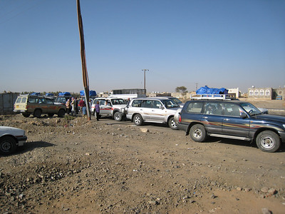The convoy of 4x4s at the checkpoint where we picked up our military escort.
