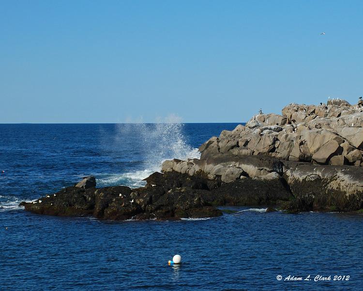 Water splashing up against the rocks
