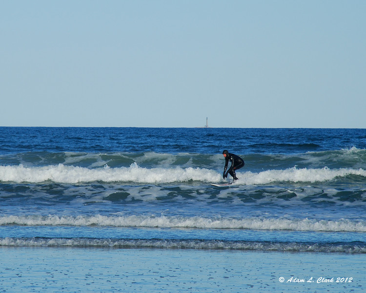 One of a couple surfers making use of the small waves