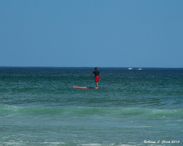 Someone paddle boarding