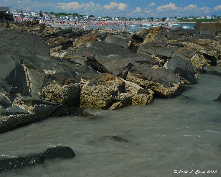 Rocky outcropping midway down the beach