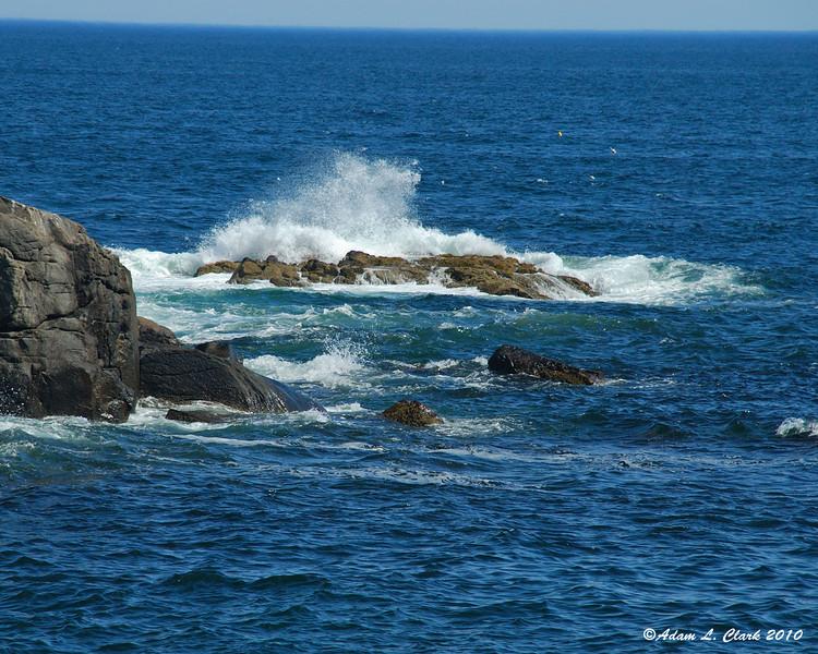 Waves splashing by the lighthouse