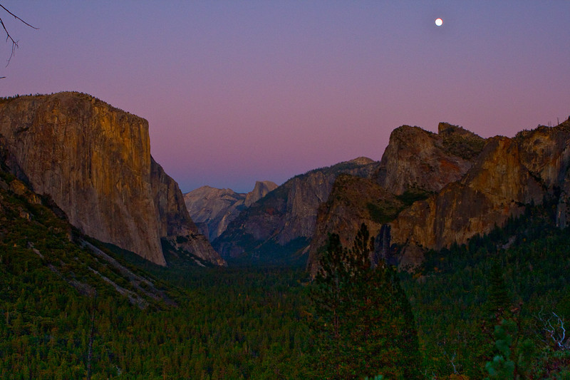 Almost a full moon. Dusk at Tunnel View, looking down the length of the Yosemite Valley, from left to right, El Capitan, Half Dome, Cathedral Rocks and Bridaveil Fall.