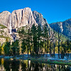 Yosemite Falls from Swinging Bridge. Overnight frost covers the shadowed meadow.