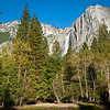 Yosemite Falls from Housekeeping Camp beach. Slight rainbow effect, overnight ice on cliff walls bordering falls.