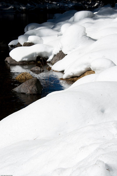 <h3>Snow Cover Bolders on The Merced River</h3>I seem to like river rocks covered with snow.  This was taken near the bridge and the head of the valley.