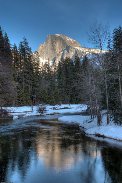 <h3>Half Dome and the Snowy Merced River</h3>We were waiting around for sunset for some pictures of Half Dome.  I was one the bridge crossing the Merced River near the Yosemite Village.<br>This was done as a HDR.