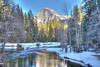 <h3>Half Dome and the Snowy Merced River</h3>We were waiting around for sunset for some pictures of Half Dome.  I was one the bridge crossing the Merced River near the Yosemite Village.<br>This was done as a HDR.  I purposely tweaked this one to look a bit surreal.