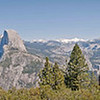 A panoramic view of Yosemite at the top of the trail we hiked, with Half Dome just left of center.<br /> <br /> This is my first attempt at a panoramic in Photoshop - and it was just so easy!