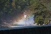Yosemite National Park. A helicopter filling with water to fight the Big Meadow fire. It's just as narrow as it looks. <br /> <br /> Photo by Dennis