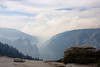 Yosemite National Park. Looking out from Sentinel Dome. The smoke from the fire spills into the valley<br /> <br /> Photo by Deb