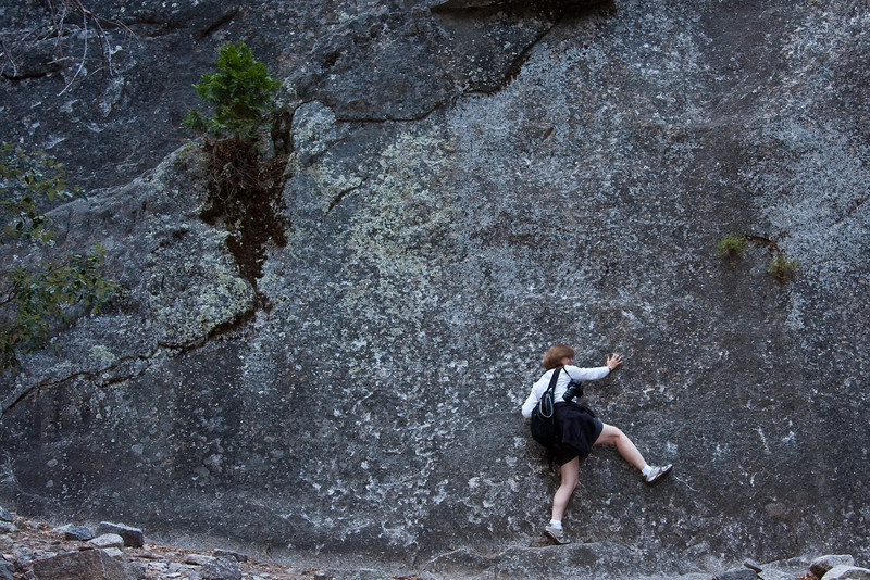 Yosemite National Park. Deb's attempt at rock climbing. This is as far as she got.<br /> <br /> Photo by Dennis
