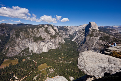 View from Glacier Point, which is the most spectacular viewpoint in Yosemite National Park, California, U.S.A.  Half Dome is a granite dome.  The granite crest rises more than 4,737 ft (1,444 m) above the valley floor and 8,842 feet (2,650 meters) above sea level.
