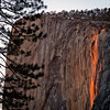 This is a photo of the Firefall at Horsetail Falls in Yosemite National Park taken in February 2013. In late February, Horsetail Falls in Yosemite National Park looks like it's on fire at the end of the sunset. <br /> <br /> This occurs due to the angle of the sunset, and would actually occur in October, too, but there's only water in this fall due to snow melt-off, and no snow is melting in October. There actually wasn't much water in it in February 2013, either, but there's just enough to make the effect work.