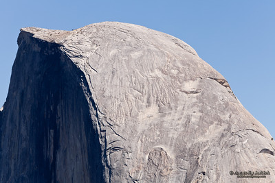 Half Dome is a granite dome in Yosemite National Park, California, U.S.A.  The granite crest rises more than 4,737 ft (1,444 m) above the valley floor and 8,842 feet (2,650 meters) above sea level.