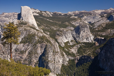 The view from Glacier Point, left to right: Half Dome, Liberty Cap, Little Yosemite Valley, Nevada Fall.  Half Dome is a granite dome.  The granite crest rises more than 4,737 ft (1,444 m) above the valley floor and 8,842 feet (2,650 meters) above sea level.
