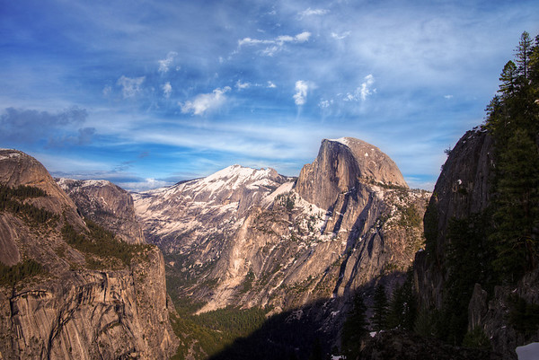 """This photo was taken from Union Point, which is the final stop on Four Mile Trail before Glacier Point, which offers arguably the best view in Yosemite. Unfortunately, the path to Glacier Point closes during the winter to (as the sign puts it) """"extreme danger.""""<br /> <br /> Read more: <a href=""""http://www.travelcaffeine.com/yosemite-national-park-snow-half-dome/"""">http://www.travelcaffeine.com/yosemite-national-park-snow-half-dome/</a>"""