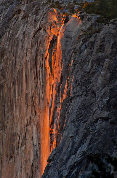 This is a telephoto shot of the Firefall at Horsetail Falls in Yosemite National Park taken in February 2013. For about 8 days each February, Horsetail Falls in Yosemite National Park looks like it's on fire at the end of the sunset.