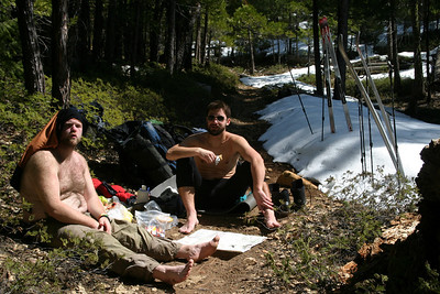 Lack of snow bedeviled the ski-bound explorers throughout the first and second days of the trip. Here, they pause to enjoy peanut butter and salami sandwiches.