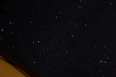 Brilliant (and blurry) stars: a view of the milky way through the tent's open door.