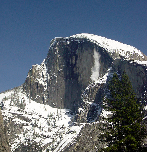 Half Dome with falling snow