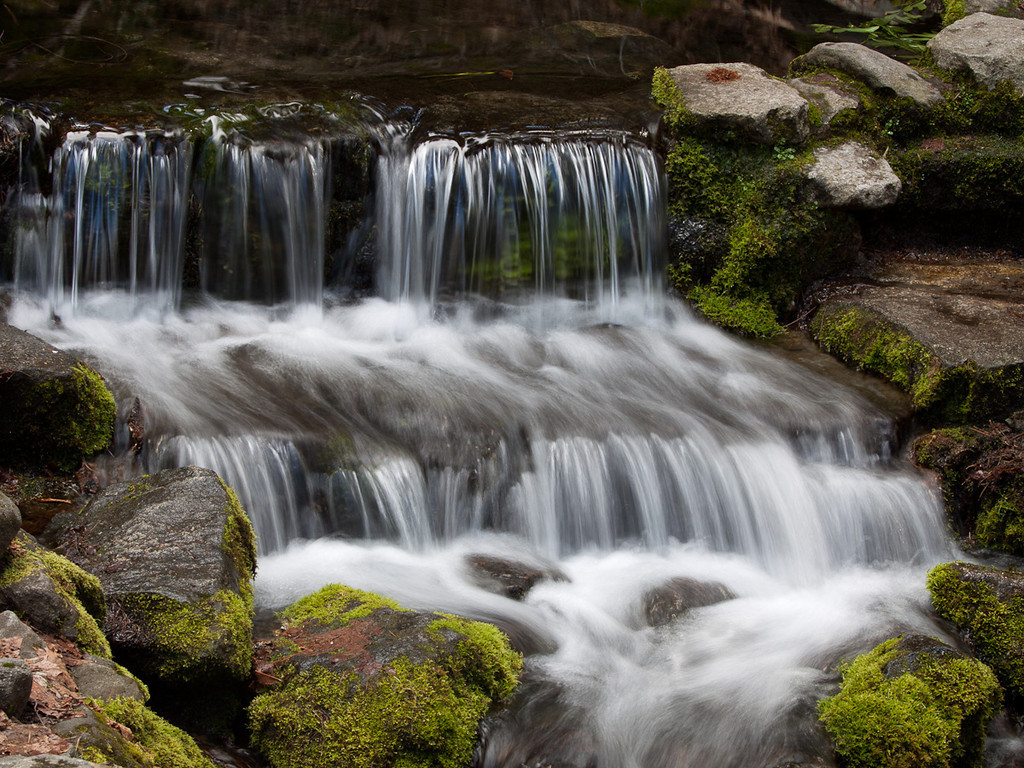 """Design: flowing curves lead the eye through the image to focal point at lower right third. Fern Spring cascade, Yosemite NP CA. Fine art print available, matted and framed, 24""""x30"""""""