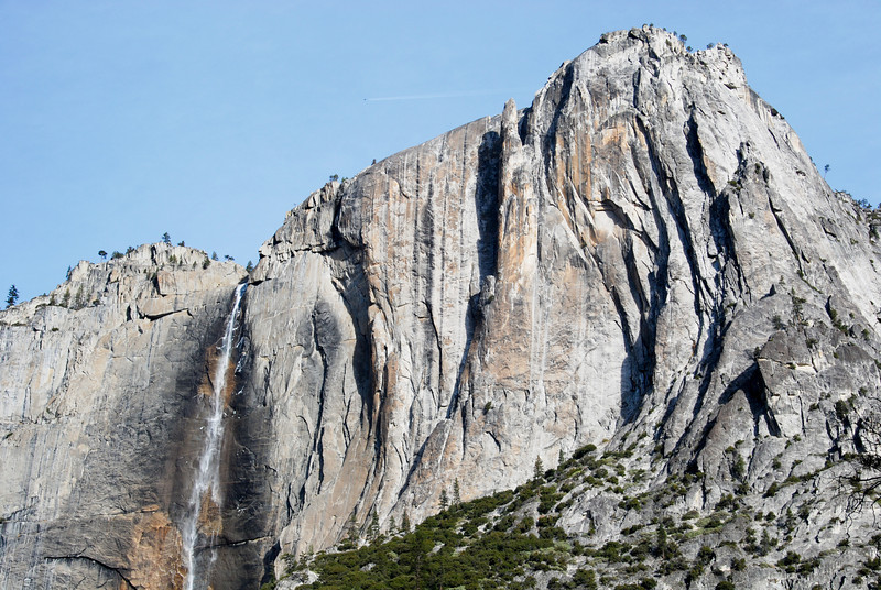 """<span id=""""title"""">Yosemite Falls</span> The upper falls is on the left, and a pointy rock formation called Lost Arrow is above and to the right. Also, an airplane."""