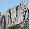 "<span id=""title"">Yosemite Falls</span> The upper falls is on the left, and a pointy rock formation called Lost Arrow is above and to the right. Also, an airplane."