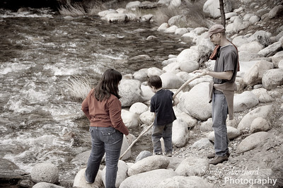 Yosemite 2010 - Michelle, Parker, and Robb playing in the river with a big stick.