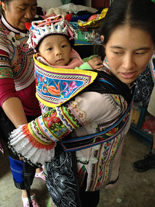 A Hani mother demonstrating the proper use of the Chinese Baby Bjorn.