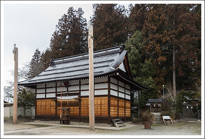 A temple.  I am not sure of the meaning of these poles, but it seems to be a bit of a custom in Nagano prefecture.  Seishi has seen them in nearby areas as well.