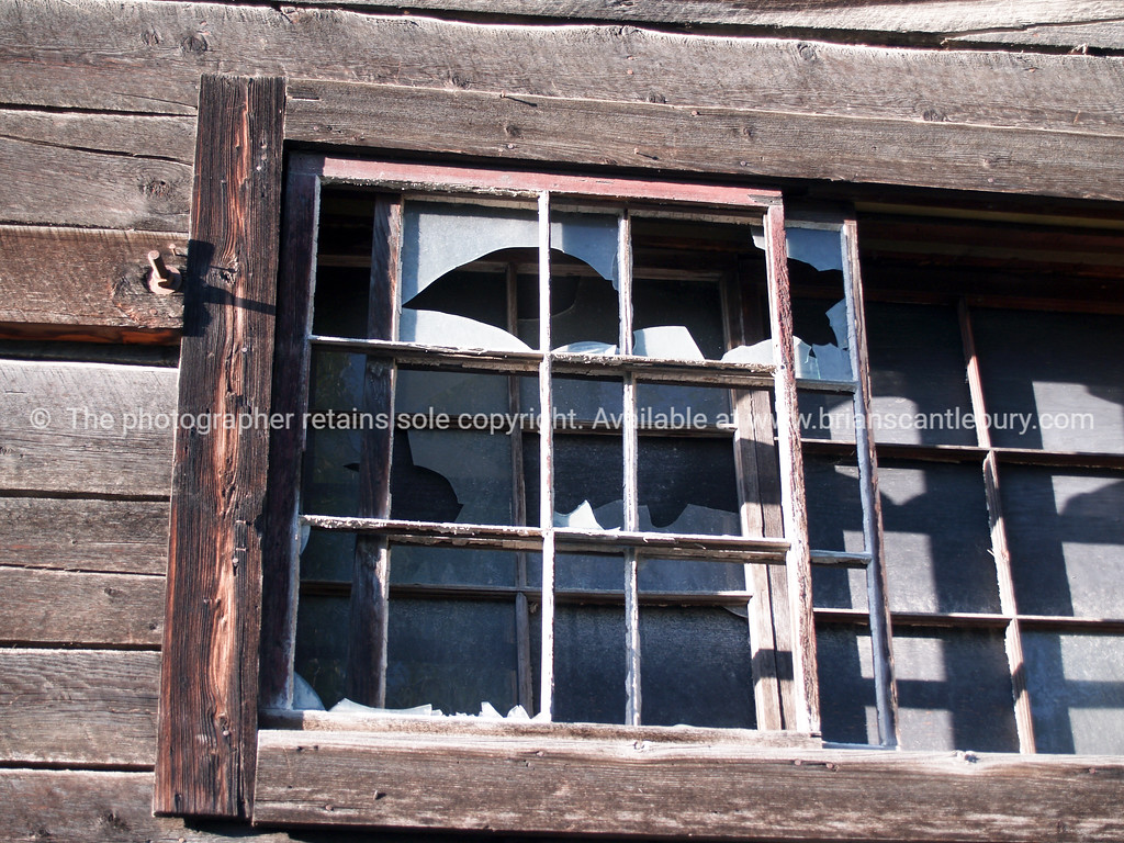 "Broken windows, close up of an old disused building, Dawson City, Yukon Territory, Canada. <br /> <br /> SEE ALSO:  <a href=""http://www.blurb.com/b/893025-north-to-alaska"">http://www.blurb.com/b/893025-north-to-alaska</a>"