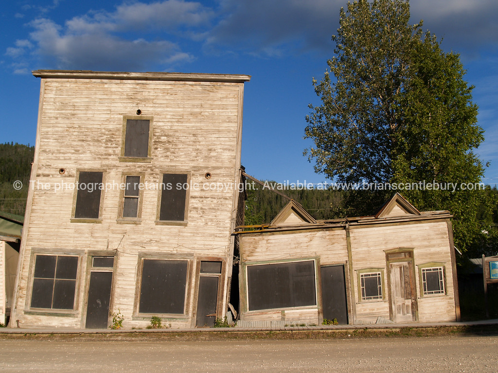 "Dawson City; Buildings falling over. Two of Dawson City's old buildings sinking into the permafrost. <br /> <br /> SEE ALSO:  <a href=""http://www.blurb.com/b/893025-north-to-alaska"">http://www.blurb.com/b/893025-north-to-alaska</a>"