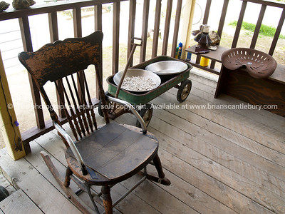 Porch of a miners home, old rocking chair, and other items.   SEE ALSO: www.blurb.com/b/893025-north-to-alaska