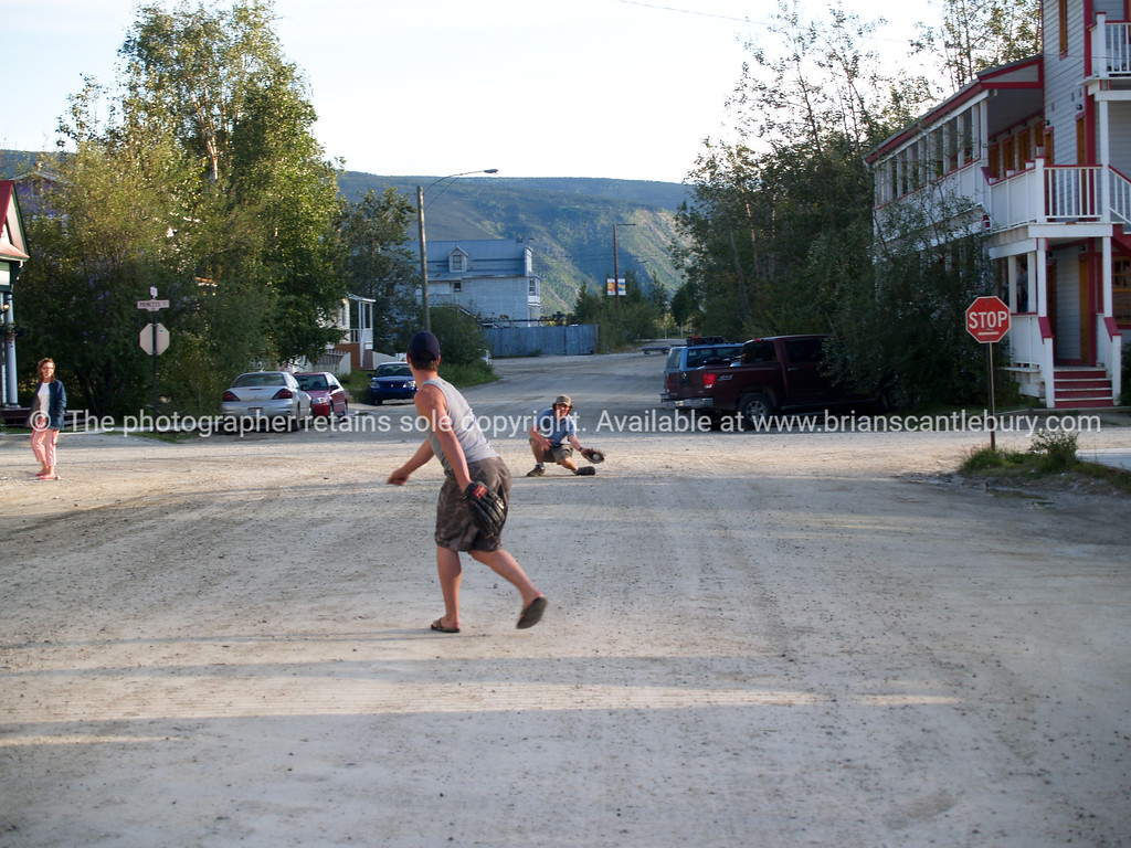 "Playing ball in street of Dawson City. <br /> <br /> SEE ALSO:  <a href=""http://www.blurb.com/b/893025-north-to-alaska"">http://www.blurb.com/b/893025-north-to-alaska</a>"