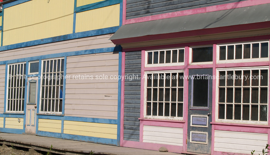 "Shop fronts, old shop fronts now vacant, Dawson City. <br /> <br /> SEE ALSO:  <a href=""http://www.blurb.com/b/893025-north-to-alaska"">http://www.blurb.com/b/893025-north-to-alaska</a>"