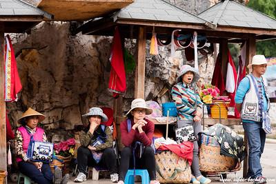 Colorful vendors looking damn sleepy