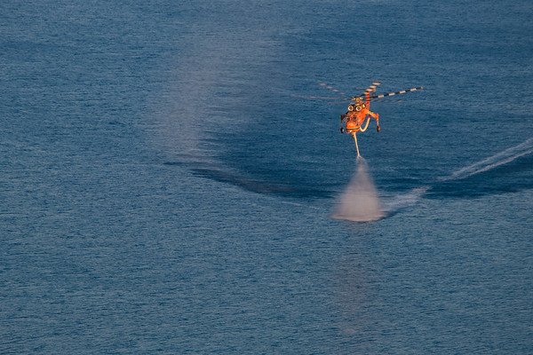 Firefighters Heli taking up Water