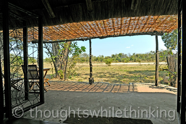 The veranda with a view out over the Kapamba River. Each chalet is only three-sided with steel gates that can enclose the open side to keep the wildlife out at night. Once we had an elephant eating that nearby tree at about 2 am.
