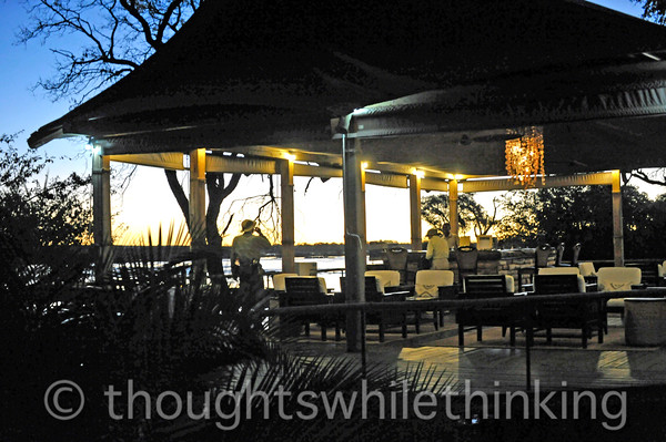 Lounge and bar area at Toka Leya Camp with a view out over the Zambezi River.