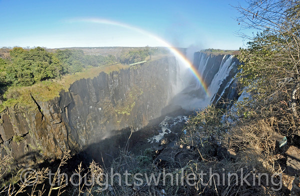 Victoria Falls. Water levels were low during this time of year, so much of the rock walls of the falls were exposed. In the rainy season, the entire length of the falls, over a mile, is covered with water from the Zambezi River, and the view and sound are more dramatic. However, the view is also more limited because of the huge volume of spray and mist arising from the gorge.