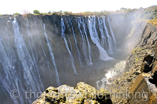 Victoria Falls. Looking east, water flows over the falls and then from right to left in this photo.