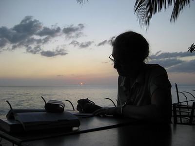 Writing postcards at sunset