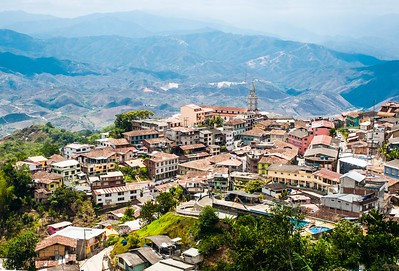 """Zaruma - Town in the Andes, Ecuador. Located in the southern province of El Oro (meaning literally """"the gold"""") in the western range of the Andes mountains, Zaruma is a lovely hilltop town with steep twisted streets, painted wooden buildings, and fabulous views of the surrounding landscape"""