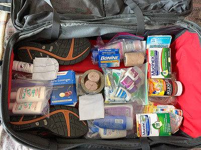 Packing - Pharmacy in the bottom of my suitcase